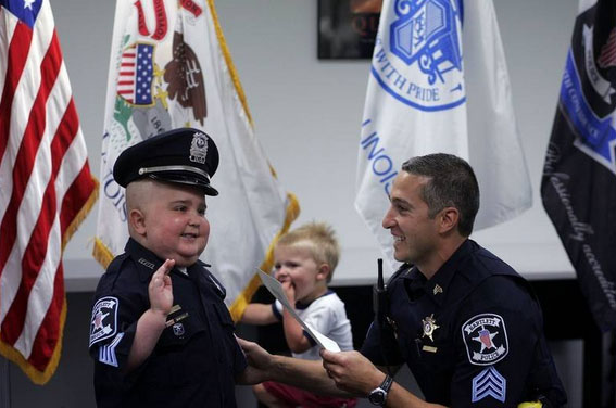 Carter Kettner was sworn in Friday as a Bartlett police officer. The 5-year-old from Huntley, who often tells his parents he wants to be a police officer, has been diagnosed with a malignant, inoperable brain tumor.